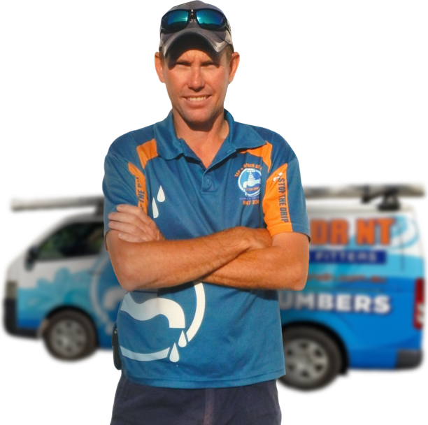 Plumber standing crossed arm in front of van