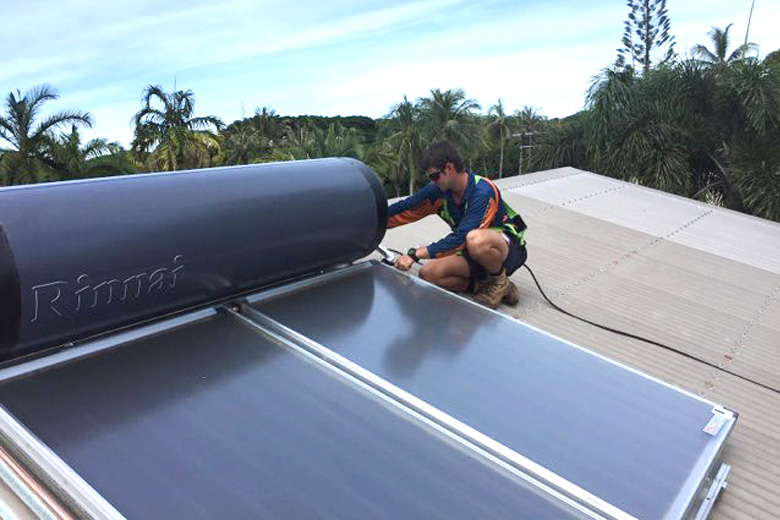 Solar hot water system being installed on roof