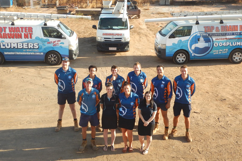 Tap and Drain Dr Nt team photo in front of company vans